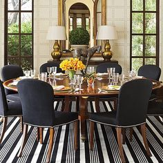 Southern Living Magazine: round dining room table, black and white with gold accents