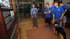Don Fenton, Pacific Air Forces deputy command historian, gives a tour of the Courtyard of Heroes to Air Force Wounded Warriors at the PACAF headquarters building, Joint Base Pearl Harbor-Hickam, Hawaii, Jan. 6, 2014. The athletes are here to compete in the 2014 Wounded Warrior Pacific Invitational which will pit more than 120 warriors against each other in cycling, seated volleyball, swimming, wheelchair basketball and track and field. (U.S. Air Force photo/Master Sgt. Jerome S. Tayborn)