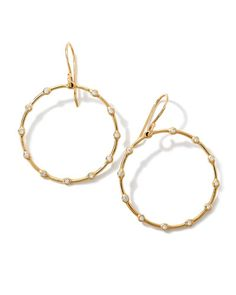 "From the Ippolita Stardust Collection. 18-karat yellow gold earrings with diamond-detailed open-circle drops. HI/S1 diamonds, 0.16 total carat weight. Approx. 1 2/3""L x 1 1/10""W (40x28mm). French hook"
