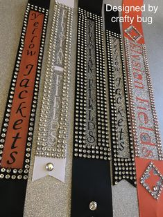 Custom school ribbons. Orange, black, and white ribbons with bling. Homecoming mums designed by crafty bug