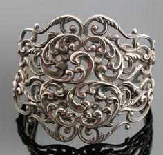 """Vintage Danecraft Sterling Silver Cuff Bracelet by SITFineJewelry     Wear it all day long through every outfit change.     Just Gorgeous, this intricately designed Cuff Bracelet will be a wonderful addition to your jewelry wardrobe.     This Cuff is Big and Bold and the design is over the top.     Danecraft started in business in 1934 and they are located in Providence, Rhode Island.    Cuff is: 2 1/4' inches in width and the inside diameter is 6 1/2"""" inches  PRICE-$695.00"""