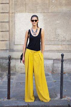 When you wear a statement color, keep it simple on top | More info on how to wear wide pants at http://40plusstyle.com/wide-legged-pants-how-to-wear-them-and-where-to-buy/