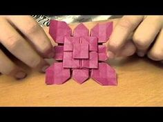 Origami Specialist teaching how to make an orogami flower type thing Please comment and tell me what you think of this video. If you had any trouble making y...