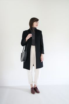 Coat n/a Reformation  Turtleneck n/a Zara  Clyde Work Pant in Natural    Modern Oxford c/o Everlane