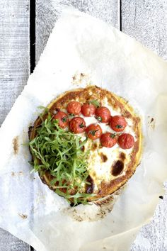 Healthy chickpea pizza with whipped mascarpone, fresh arugula and a delicious homamde tomato sauce with roasted tomatoes