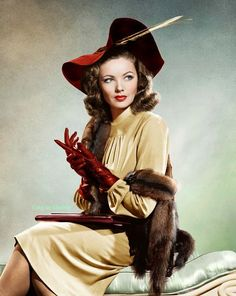 Gene Tierney 40s vintage fashion style tan gold dress day wear red hat gloves fur movie star portrait icon color print ad