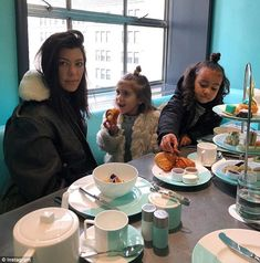 Do it up!Both little girls sported adorable top-knot buns as they scoffed mini sandwiche...