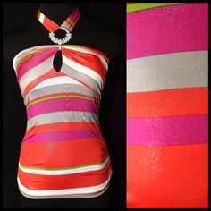 "Pink Orange Metallic Stripe Halter Top Small ‼️ PRICE FIRM UNLESS BUNDLED WITH OTHER ITEMS FROM MY CLOSET ‼️   Bright shades of pink, orange, green & silver with a metallic shine.   Built in bra cups.  Rhinestone halter tie.  Lots of stretch to this top for a perfect fit.  96% polyester 4% spandex.  All measurements are taken with garment lying flat. SMALL Bust up to 34"" Length of garment 20"" From top of bust  MEDIUM Bust up to 36"" Length of garment 21"" From top of bust Flamingo Tops"