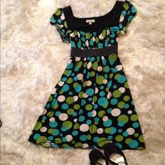 The perfect Easter dress! Silky feel to this perfect dress! Black with white, green and teal dots.  Polyester and spandex.  Machine washable. Dresses Midi
