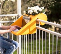 The BalKonzept is a German designed desk for your balcony. Just place it over the railing on your balcony and you have a desk to work at, a table to set your drinks on, or a place to put some flowers.                                                                                                                                                                                 More
