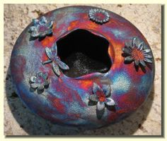 raku flower and dragonfly saucer vase  Just love this! What a great piece for the garden!