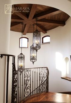 IRON WORK - LANTERNS, RAILING beamed rounded ceiling with custom wrought iron lighting, pendants, and stair railing. Walnut planks on top of this arched Spanish staircase. Home Stairs Design, Interior Stairs, House Design, Wrought Iron Stair Railing, Wrought Iron Chandeliers, Wooden Staircases, Mediterranean Homes, Interior Design, Architecture