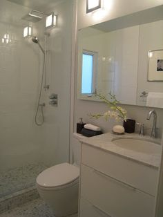CREED: Victorian Row House: A Designer Reno on A DIY Budget - Part 4 - long mirror over small vanity and toilet to max space