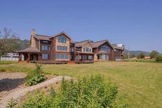 Alaska's Most Expensive Home Is a $9M 'Peter Pan'-Themed Mansion   realtor.com® Expensive Houses, Most Expensive, Kenai Peninsula, Turkish Bath, Black Exterior, Luxury Spa, Custom Lighting, Vacation Spots, Peter Pan
