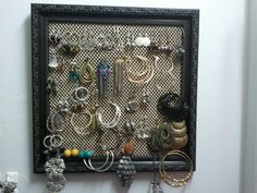 Earring holder made with drawer liner and an old picture frame.