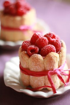 "dessert. Fresh Raspberries all wrapped up in a lady finger ""fence"""