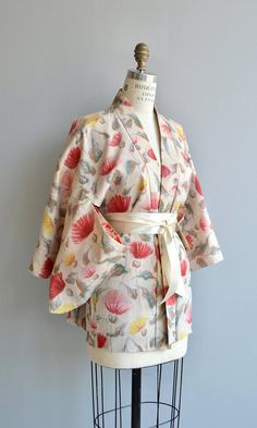 Vintage 1950s ivory silk haori jacket with pink and yellow floral print and elbow length sleeves. Shown with long cream sash, not included. ✂-----Measurements fits like: one size fits most length: 29 brand/maker: n/a condition: some very faint discoloration at the lapel, quite faint, see close up photo ✩ vintage lingerie ✩ http://www.etsy.com/shop/DearGoldenVintage?section_id=7337122 ✩ visit the shop ✩ http://www.DearGoldenVintage.etsy.com