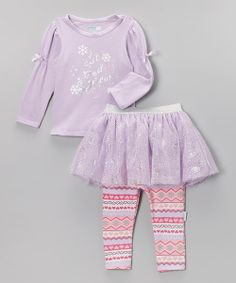 Bitty snow bunnies will love this shimmery, frost-inspired ensemble. A glimmering skirt and snowflakes on the top add a sprinkling of girliness, while Fair Isle leggings ensure little ladies stay snug and comfy.Includes tee, skirt and leggingsTee: 94% cotton / 6% spandexSkirt: 100% polyesterLeggings: 96% cotton / 4% spandexMachine wash; tumble dryImported