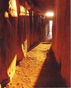 """Newgrange, Ireland. The sun entering the passageway Winter Solstice. """"There is no agreement about what the site was used for, but it has been speculated that it had religious significance – it is aligned with the rising sun and its light floods the chamber on the Winter Solstice."""""""