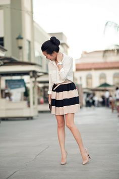 stripe skirt. loose white shirt. nude heels.