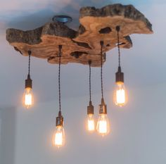 Please read full description before purchasing. This listing shows an example of a medium olive wood light fixture. This fixture is already SOLD. Contact 7M to customize the perfect fixture for your space. This custom live-edge olive wood light fixture makes an artistic centerpiece for