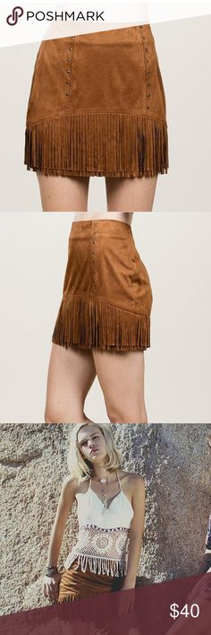 Fringe Suede Skirt Camel Suede Fringe Mini Skirt is Sexy and Chic. This is a must have for your Boho closet. Pair with denim shirt and booties for an effortless Fall look.  Product Details Camel colored Faux Suede Fringe Mini Skirt High-waisted mini skirt Micro-stud detail on front Fringe detail Hem Fully lined 100% Polyester nakedfashion.co Skirts Mini