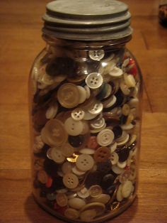 .Vintage buttons in a vintage jar. I'd love to get something like this in my Christmas stocking.