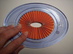 Make perfect oval rosettes using  Creative Memories Oval Cutter to hold in place while gluing.