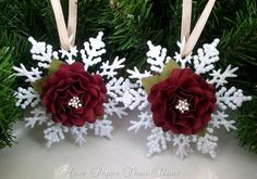 Lovely snowflake ornaments! (no longer available on etsy)  Paper flower on a dollar store snowflake would be the same.