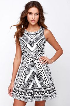 "You won't hesitate to say ""I do"" to the sweet look of the Mirror Me Black and Ivory Print Dress! Sleek cotton material holds a touch of stretch forming this cute skater dress with a rounded neckline, sleeveless bodice, and darted detail. A bold black and ivory mirror print plays out in Baroque and geometric patterns front and back, with a flirty and flaring skirt topping off the look below. Hidden back zipper with clasp. Unlined. 98% Cotton, 2% Spandex. Hand Wash Cold. Imported."