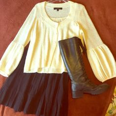 Nine West sweater Only worn once, great condition, and the sleeves are adorbs! Boots and skirt are not for sale. No trades for the sweater, but make me an offer! Nine West Sweaters Cardigans