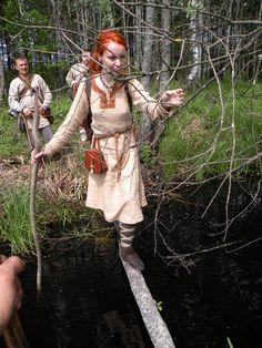 Early medieval travel clothes: woolen natural dyed dress- knee lenght, woolen trousers, woolen leg warmers, linen under dress.