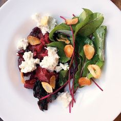 Francis Mallmann's Seven Fires: Grilling the Argentine Way. Recipe for Smashed Beets with Greens, Goat Cheese, and Garlic Chips.