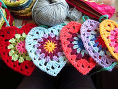 These granny square crocheted hearts would make good Christmas tree ornaments.