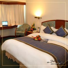 Decorated in shades of cream and accented by dark wood furnishings, our guest rooms and suites exude elegant comfort and style. Gaze over the beautiful lush green campus and enjoy your vacations in the lap of nature in the cozy snuggle of #ParkRidgeResorts.