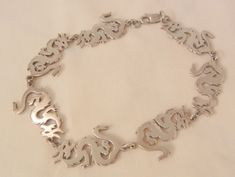 Always something exciting in store many items on sale from 10 to 60% off Fabulous Sterling Asian Serpent dragon Bracelet