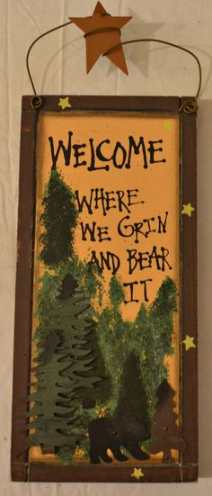 "Rustic Country Wood Plaque Sign Decoration with a Metal Wire for Hanging 5 1/2 x 12 x 3/4 Inches. Wooden Sign Saying ""Welcome Where We Grin And Bear It"" with Decoration Metal Pine Trees, Black Bear, Hand Painted Pine Trees, and Brown Border"
