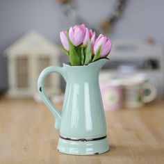 Our simple yet stunning green ceramic Normandy style pitcher is coated in enamel to give it an intentionally aged look and antique feel. You can almost picture it on the table of a rustic farm house brimming with water to wash down a well earned feast at the end of a long days toil.     Find it at:  http://www.pasttimes.com/gift_finder/by_occasion/easter_gifts/green_normandy_pitcher-870899.htm