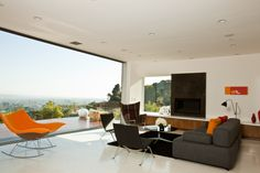 """Los Angeles architecture firm Assembledge oriented the house on the flat promontory, ensuring sightlines from every room. """"We wanted to extend what we see as the great Southern California modernist project where there is a real integration of indoors and outdoors,"""" Kevin Southerland of Assembledge says. Here we see the downstairs living room."""
