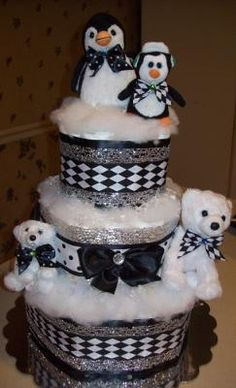 """Holiday themed diaper cake. Love the fluffy """"snow"""" on this."""