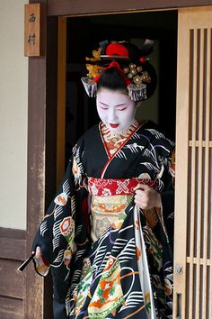 Maiko (舞妓?) is an apprentice geisha in western Japan, especially Kyoto. Their jobs consist of performing songs, dances, and playing the shamisen (three-stringed Japanese instrument) for visitors during feasts. Maiko are usually aged 15 to 20 years old and become geisha after learning how to dance (a kind of Japanese traditional dance), play the shamisen, and learning Kyō-kotoba (dialect of Kyoto), regardless of their origins. http://en.wikipedia.org/wiki/Maiko