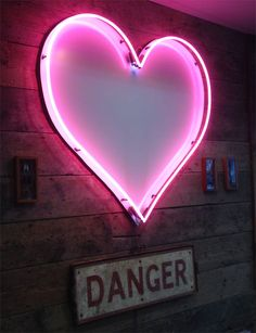 pink neon heart danger