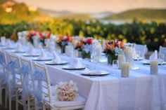 Reception Table photographed by Blue Glass Photography. Flowers Roses too, decor Island Style Weddings