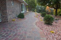 outdoor sidewalks backyard   Custom Brick Paver Patios - Outdoor Innovations - Omaha
