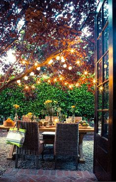 Perfect outdoor lighting handing from the trees in the patio and backyard space. Great use of lighting in s small space. This would look great for a backyard wedding! Outdoor Areas, Outdoor Rooms, Outdoor Dining, Outdoor Decor, Patio Dining, Dining Area, Dining Table, Ar Fresco, Beach Tent