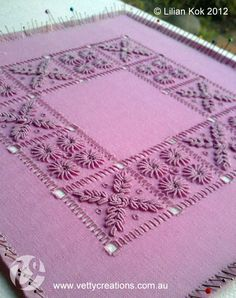 """Portuguese whitework in purple! (shown being damp stretched.) Stitched by Lilian Kok, Netherlands. The design is """"square mat"""" from """"Portuguese Whitework: Bullion Embroidery from Guimarães"""" by Yvette Stanton."""