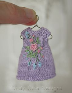 Pretty in Pink Roses, a hand knit and embroidered dress for Amelia Thimble dolls. cindyricedesigns.com