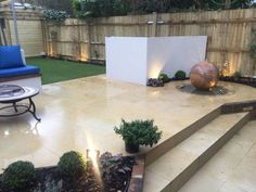 This is the rectangular rear garden to an Edwardian property in Fulham.