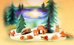 Ostheimer Forest Animals Set with Diorama. Includes 10 woodland animals, a spruce tree, and cardboard backdrop. From Bella Luna Toys.