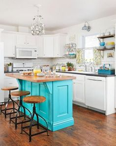 Secondhand finds and low-cost materials—including an island of reclaimed wood—bring thrifty country style to this Indiana kitchen. More kitchen ideas: http://www.midwestliving.com/homes/room-decorating/kitchen-styles/page/13/0
